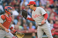 Philadelphia Phillies pitcher Jamie Moyer meets with catcher Brian Schneider against the Houston Astros on Turn Back the Clock Nite. Game played on Saturday April 10th, 2010 at Minute Maid Park in Houston, Texas.  (Photo by Andrew Woolley / Four Seam Images)