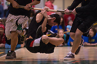Young men compete in the Wrist Carry at the 44th Annual Native Youth Olympics at the Dena'ina Center in downtown Anchorage, Alaska. The games are open to boys and girls from all backgrounds and encourage friendly competition and healthy lifestyles as participants strive for their personal best in a variety of traditional Native Alaskan contests.