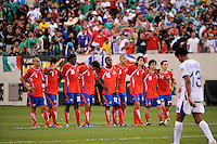 Costa Rica players watch as Carlo Costly (13) of Honduras walks back to the team after scoring a penalty kick. Honduras defeated Costa Rica on penalty kicks after playing to a 1-1 tie during a quarterfinal match of the 2011 CONCACAF Gold Cup at the New Meadowlands Stadium in East Rutherford, NJ, on June 18, 2011.