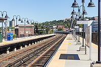 A Metro-North Hudson Line train heads north out of the station in Yonkers, New York.