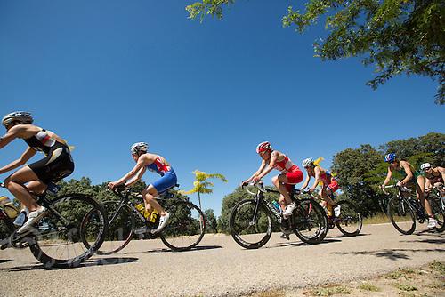 01 JUN 2013 - MADRID, ESP - Competitors on the bike during the elite women's ITU 2013 World Triathlon Series round at Casa de Campo in Madrid, Spain (PHOTO (C) 2013 NIGEL FARROW)