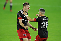 WASHINGTON, DC - OCTOBER 28: Julian Gressel #31 of D.C. United celebrates his score with teammate Joseph Mora #28 of D.C. United during a game between Columbus Crew and D.C. United at Audi Field on October 28, 2020 in Washington, DC.