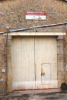 Domaine Leon Barral, Faugeres. Faugeres. Languedoc. A door. France. Europe.