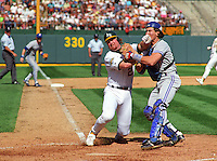 OAKLAND, CA - Oakland Athletics base runner Mark McGwire is tagged out at home plate by Toronto Blue Jays catcher Pat Porders during game 3 of the American League Championship Series at the Oakland Coliseum in Oakland, California on October 8, 1992. (Photo by Brad Mangin)
