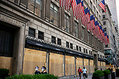 New York New York<br /> June 12, 2020<br /> <br /> Security in front of Saks Fifth Avenue is reduced as razor wire, guard dogs and the number of men is reduced weeks after looting takes place throughout Manhattan.