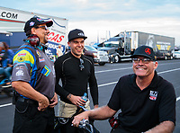 Aug 31, 2018; Clermont, IN, USA; NHRA funny car driver Jonnie Lindberg (center) with crew members during qualifying for the US Nationals at Lucas Oil Raceway. Mandatory Credit: Mark J. Rebilas-USA TODAY Sports