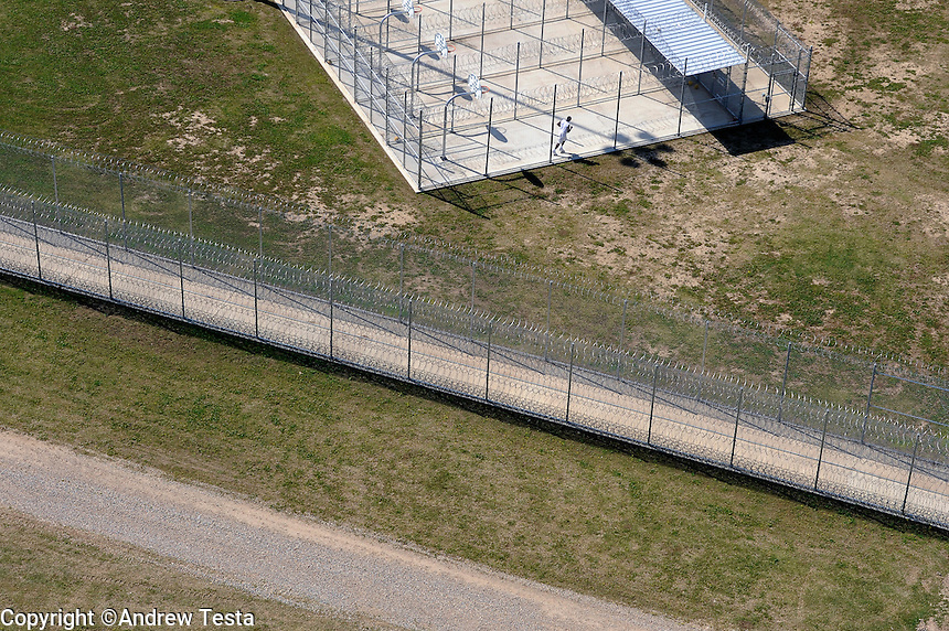 USA. Angola. 21st April 2008.Death Row prisoners exercise in individual pens. They are separated from other inmates by fences and razor wire..©Andrew Testa