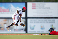 Danville Braves shortstop Nicholas Shumpert (1) can't handle a throw as Colton Waltner (26) of the Elizabethton Twins slides into second base at American Legion Post 325 Field on July 1, 2017 in Danville, Virginia.  The Twins defeated the Braves 7-4.  (Brian Westerholt/Four Seam Images)