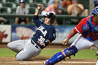 New Orleans Zephyrs catcher Luke Montz #30 slides home during the Pacific Coast League baseball game against the Round Rock Express on May 2, 2012 at The Dell Diamond in Round Rock, Texas. The Express defeated the Zephyrs 10-5. (Andrew Woolley / Four Seam Images)