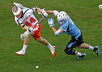 Virginia Cavaliers Chris LePeirre (44) is defended by Johns Hopkins John Greeley (9) during the game in Charlottesville, VA. Johns Hopkins defeated Virginia 11-10 in overtime.Photo/Andrew Shurtleff