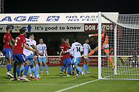 Will Wright of Dagenham and Redbridge scores the third goal for his team direct from a corner during Dagenham & Redbridge vs Weymouth, Vanarama National League Football at the Chigwell Construction Stadium on 14th September 2021