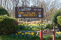 A sign welcomes visitors to the town/village of Harrison, New York