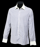 BNPS.co.uk (01202) 558833. <br /> Pic: Ewbanks/BNPS<br /> <br /> Pictured: Also included in the sale is Roger Moore's screen-worn shirt from the pre-title sequence of For Your Eyes Only. The estimate is £6,000.<br /> <br /> A rare movie poster for the James Bond film Thunderball that was designed to be torn into four pieces is tipped to sell for £12,000.<br /> <br /> The quad poster contains four individual works of art promoting the 1965 movie.<br /> <br /> The panels show Sean Connery as 007 flying through the air in a jet suit, being mobbed by glamorous women, fighting a scuba diver and sat on a beach poised with weapon in hand.