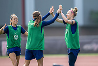 CLEVELAND, OH - SEPTEMBER 14: Tobin Heath congratulates Becky Sauerbrunn of the United States on a goal during a training session at the training fields on September 14, 2021 in Cleveland, Ohio.