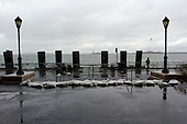 New York, New York.October 30, 2012..Sandbags strewn around Battery Park, unable to sustain the blast of Hurricane Sandy.