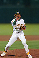 OAKLAND, CA - Dennis Eckersley of the Oakland Athletics pumps his fist, yells and celebrates after getting a save during a game at the Oakland Coliseum in Oakland, California in 1992. Photo by Brad Mangin
