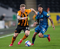 Hull City's Thomas Mayer takes on Grimsby Town's Kyle Bennett<br /> <br /> Photographer Alex Dodd/CameraSport<br /> <br /> EFL Papa John's Trophy - Northern Section - Group H - Hull City v Grimsby Town - Tuesday 17th November 2020 - KCOM Stadium - Kingston upon Hull<br />  <br /> World Copyright © 2020 CameraSport. All rights reserved. 43 Linden Ave. Countesthorpe. Leicester. England. LE8 5PG - Tel: +44 (0) 116 277 4147 - admin@camerasport.com - www.camerasport.com