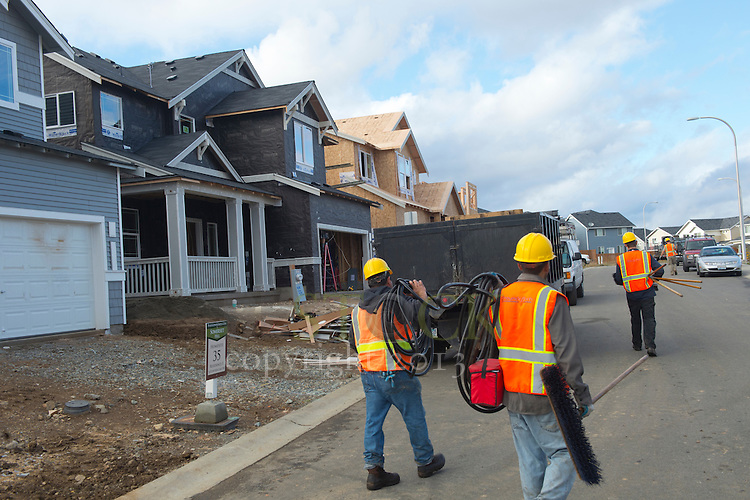 Construction Workers Carrying Supplies