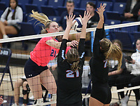 Kyla Chub (20) of Har-ber spikes ball against  Sophia Neilhouse (21) and Olivia Melton (7) of South Side on Tuesday, October 12, 2021, during play at Wildcat Arena, Springdale. Visit nwaonline.com/211013Daily/ for today's photo gallery.<br /> (Special to the NWA Democrat-Gazette/David Beach)