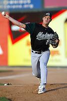 Brad Sullivan of the Modesto Athletics throws in the bullpen before a 2004 season California League game against the Island Empires 66ers at San Manuel Stadium in San Bernardino, California. (Larry Goren/Four Seam Images)