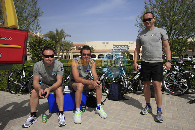 Omega Pharma-Quick Step team mechanics wait for their riders to arrive before the start of the 3rd Stage of the 2012 Tour of Qatar running 146.5km from Dukhan Souq, Dukhan to Al Gharafa, Qatar. 7th February 2012.<br /> (Photo Eoin Clarke/Newsfile)