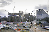 - Milan, construction site for urban planning conversion of Portello area, pedestrian footbridge over Renato Serra driveway....- Milano, cantieri edili per la riconversione urbanistica dell'area del  Portello, passerella pedonale su viale Renato Serra