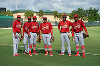 GCL Cardinals (L-R) Yowelfry Rosario (11),Franklin Soto (5), Francisco Hernandez (4), Pablo Gomez (22), Luis Montano (19), and Freddy De Jesus (29) before a Gulf Coast League game against the GCL Marlins on August 11, 2019 at the Roger Dean Chevrolet Stadium Complex in Jupiter, Florida.  GCL Marlins defeated the GCL Cardinals 9-2.  (Mike Janes/Four Seam Images)