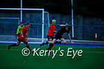 Park FC captain Sebastian Vasiu and Liam Tobin of Elton Wanderers tussle for possession during their soccer game on Friday.
