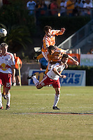 Houston Dynamo defender Eddie Robinson (2), Dynamo midfielder Ricardo Clark (13), and New York Red Bulls midfielder Sinisa Ubiparipovic (8) go up for the header.  New York Red Bulls defeated Houston Dynamo 3-0 for an aggregate  score of 4-1 over Houston Dynamo   at Robertson Stadium in Houston, TX on November 9, 2008 in the second leg of the Western Conference semifinals.  Photo by Wendy Larsen/isiphotos.com