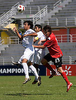 David Carranza (11) and Julio Moncada (9) of Honduras go up for a header with Luca Gasparotto (13) of Canada during the group stage of the CONCACAF Men's Under 17 Championship at Catherine Hall Stadium in Montego Bay, Jamaica. Canada tied Honduras, 0-0.