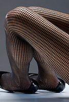 Woman's legs in fish net stockings<br />