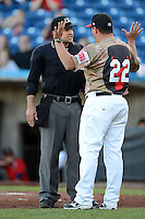 Quad Cities River Bandits manager Omar Lopez #22 argues a call with umpire Charlie Ramos during a game against the Wisconsin Timber Rattlers on May 24, 2013 at Modern Woodmen Park in Davenport, Iowa.  Quad Cities defeated Wisconsin 4-3  (Mike Janes/Four Seam Images)