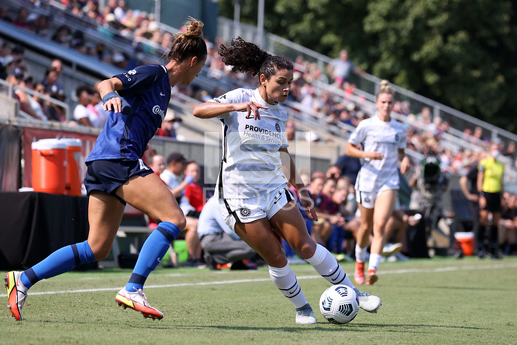 CARY, NC - SEPTEMBER 12: Rocky Rodriguez #11 of the Portland Thorns FC is defended by Carson Pickett #4 of the North Carolina Courage during a game between Portland Thorns FC and North Carolina Courage at Sahlen's Stadium at WakeMed Soccer Park on September 12, 2021 in Cary, North Carolina.
