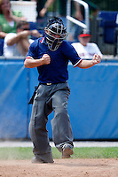 July 28, 2009:  Home plate umpire Chris Nguyen during a game at Dwyer Stadium in Batavia, NY.  Photo By Mike Janes/Four Seam Images