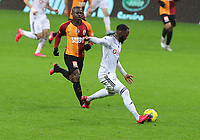 15th March 2020, Istanbul, Turkey;  Kevn Nkoudou of Besiktas and Jean Michael Seri L of Galatasaray during the Turkish Super league football match between Galatasaray and Besiktas at Turk Telkom Stadium in Istanbul , Turkey on March 15 , 2020.