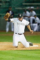 Grand Junction Rockies first baseman Ben Waldrip (40) has trouble with a low throw during the Pioneer League game against the Billings Mustangs at Suplizio Field on July 24, 2012 in Grand Junction, Colorado.  The Rockies defeated the Mustangs 4-3.  (Brian Westerholt/Four Seam Images)