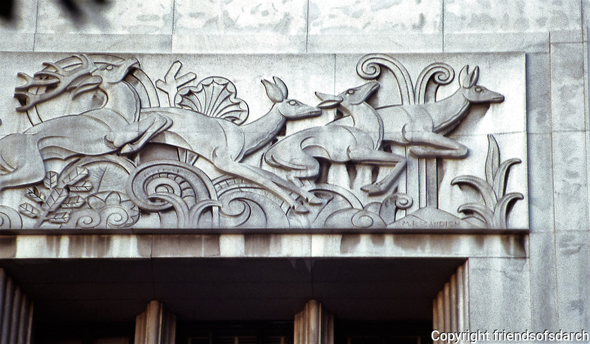 Los Angeles: I. Magnin Wilshire Boulevard--detail over entrance.  Art Deco style. Built in 1928.