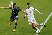 ST PAUL, MN - NOVEMBER 4: Alvaro Medran #10 of Chicago Fire FC and Ethan Finlay #13 of Minnesota United FC battle for the ball during a game between Chicago Fire and Minnesota United FC at Allianz Field on November 4, 2020 in St Paul, Minnesota.