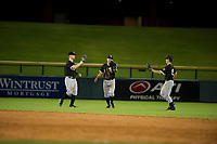 AZL White Sox outfielders Alex Destino (18), Jose Garcia (7), and JJ Muno (15) celebrate after a victory against the AZL Cubs on August 13, 2017 at Sloan Park in Mesa, Arizona. AZL White Sox defeated the AZL Cubs 7-4. (Zachary Lucy/Four Seam Images)