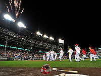 30 September 2009: Members of the Washington Nationals rush to congratulate Justin Maxwell at home plate after a game against the New York Mets at Nationals Park in Washington, DC. The Nationals rallied in the bottom of the 9th inning on Maxwell's walk-off Grand Slam to win 7-4 and sweep the Mets 3-game series capping the Nationals' 2009 home season. Mandatory Credit: Ed Wolfstein Photo