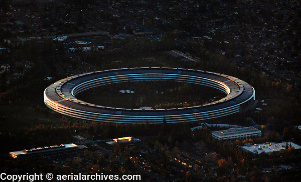 aerial photograph Apple Park, Cupertino, Santa Clara County, California at dusk