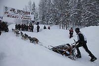 Sunday February 26, 2012  Conway Seavey runs up the bank off of Willow Lake to take first place in the 2012 Junior Iditarod.