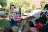 Christina Clark the Children's Librarian at the Bentonville Library reads a book Friday, Oct. 8, 2021, about fireman before kids where about to look at  real fire truck. The Bentonville Fire Department had one of their fire truck at the Library during a children's story time to allow kids to look and learn about fire trucks and fireman equipment after the reading Go to nwaonline.com/211008Daily/  to see more photos from around Northwest Arkansas. (NWA Democrat-Gazette/Spencer Tirey)