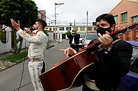 BOGOTA, COLOMBIA - MAY 20: Musicians dressed as a traditional Mexican singer knows as Mariachi, perform for free looking for some future clients on May 20, 2020 in Bogota, Colombia. Colombian President Ivan Duque extended COVID-19 lockdown until May 31. He also anticipated that   several economic activities and industries will start reopening from June 1, following health protocols and restrictions. (Photo by John Vizcaino/VIEWpress)