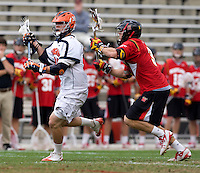 Brian Carroll (36) of Virginia holds the ball away from Jake Bernhardt (3) of Maryland during the ACC men's lacrosse tournament finals in College Park, MD.  Virginia defeated Maryland, 10-6.