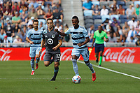 ST. PAUL, MN - AUGUST 21: Gadi Kinda #17 of Sporting Kansas City and Ethan Finlay #13 of Minnesota United FC chase the ball during a game between Sporting Kansas City and Minnesota United FC at Allianz Field on August 21, 2021 in St. Paul, Minnesota.