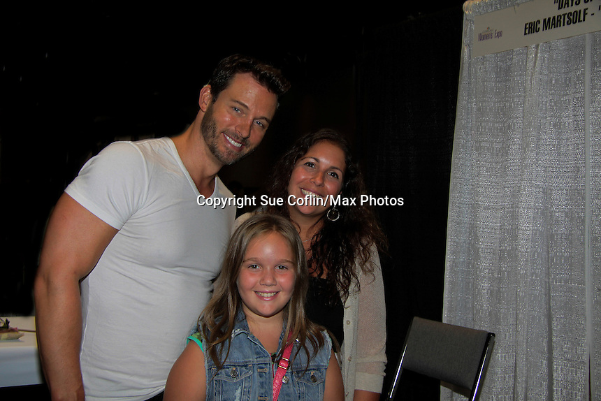 """Days of Our Lives Eric Martsolf """"Brady Black"""" poses with fans Bella (C) and mom Elise Garbeck while Eric appears at the 12th Annual Comcast Women's Expo on September 7 (also 6th), 2014 at the Connecticut Convention Center, Hartford, CT. He signed photos, posed with fans, walked the runway with models from Kathy Faber Designs Fashion Show, and broke some boards at Villari's Martial Arts Centers booth with Maggie and Ryan Farley.  (Photo by Sue Coflin/Max Photos)"""