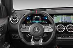 Car pictures of steering wheel view of a 2021 Mercedes Benz GLB AMG-35 5 Door SUV Steering Wheel
