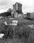 A painter at work at Ross castle, Killarney in the 1950's..Photo: macmonagle.com archive