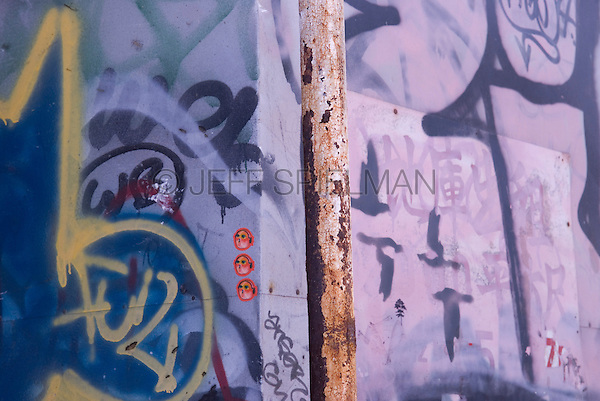Rusty Pipe and Wall Covered with Graffiti and Street Art....Eldridge Street, Lower East Side, New York City, New York State, USA